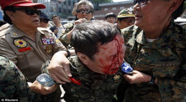 Foto : veteran perang Korea terluka di demonstrasi (Reuters)