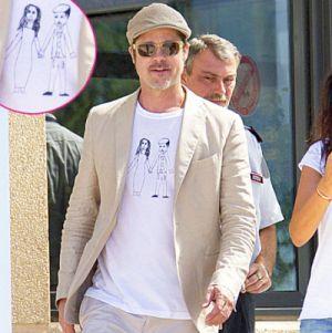 Brad Pitt pamer kaos rancangan putrinya (Foto: USMagazine)
