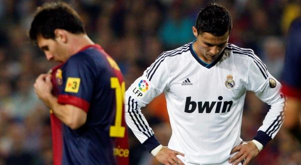 Cristiano Ronaldo dos Santos Aveiro dan Lionel Andres Messi saling pamer magis (Foto: Reuters)