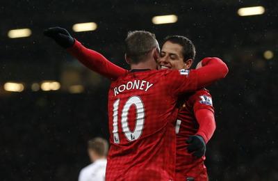 Wayne Rooney dan Chicharito inspirator kemenangan Manchester United/Reuters