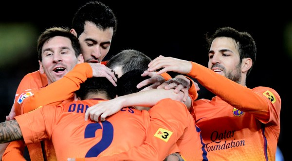 Dua gol Lionel Messi (kiri) amankan tiga poin Barcelona dari Granada (Foto: Reuters)