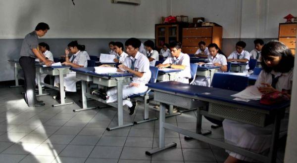 Ilustrasi: suasana ujian nasional. (Foto: Okezone)