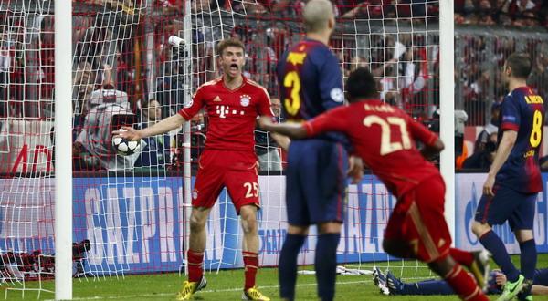 Selebrasi Thomas Mueller usai menjebol gawang Barca. (Foto: Reuters)