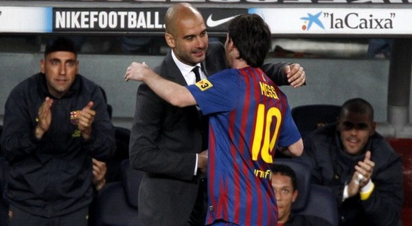 Pep Guardiola & Lionel Messi (Foto: Daylife)