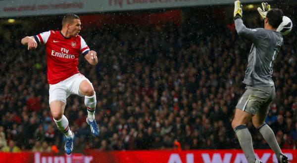 Dua gol Lukas Josef Podolski (kiri) turut memastikan Wigan  Athletic turun kasta dari Premier League (Foto: Reuters)