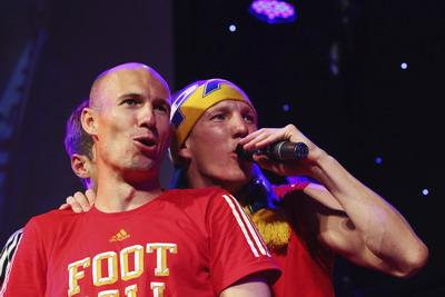 Arjen Robben (kiri).(foto:Reuters)