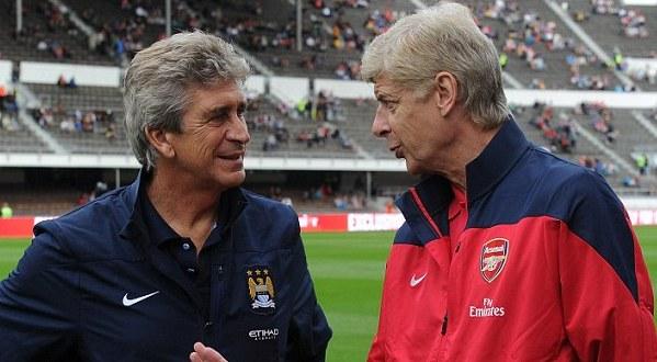 Manuel Luis Pellegrini Ripamonti (kiri) sepakat dengan Arsene Wenger terkait keganjilan transfer Juan Manuel Mata Garcia (Foto: ArsenalFC)