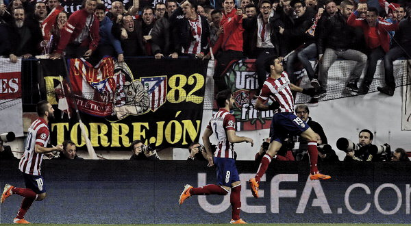Selebrasi Diego Costa usai mencetak gol ke gawang AC Milan (foto: Reuters)