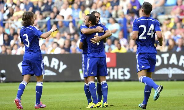 Cesc Fabregas (nomor 4) saat merayakan gol (Foto: Reuters)