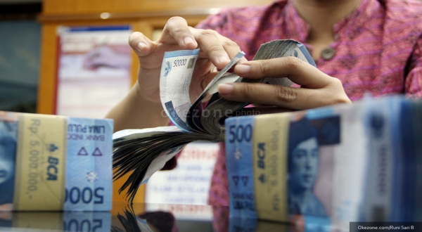 Rupiah Menguat Namun Tetap Tertahan di Rp11.930/USD