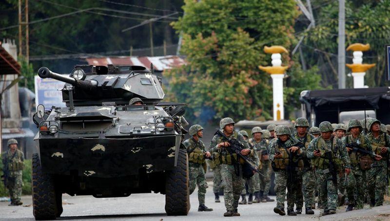 https: img.okeinfo.net content 2017 12 31 18 1838028 pasukan-keamanan-filipina-bersihkan-kota-marawi-dari-senjata-dan-bom-tanam-gDyf9Cz506.jpg