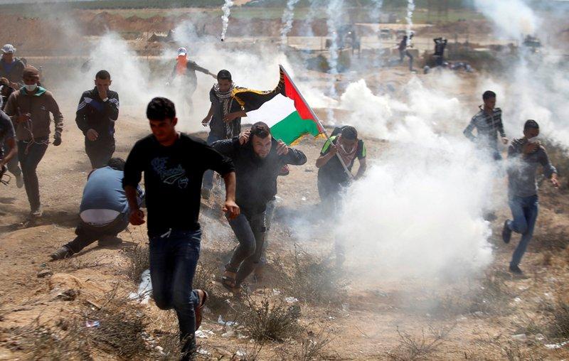 https: img.okeinfo.net content 2018 06 09 18 1908630 tentara-israel-bunuh-4-warga-palestina-dan-lukai-600-orang-lainnya-a5gGmwiEyU.jpg