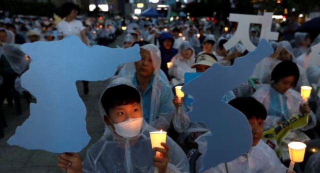 https: img.okeinfo.net content 2018 06 12 18 1909499 rakyat-korea-selatan-optimis-ktt-trump-kim-hasilkan-perdamaian-IkubBPrWpI.jpg