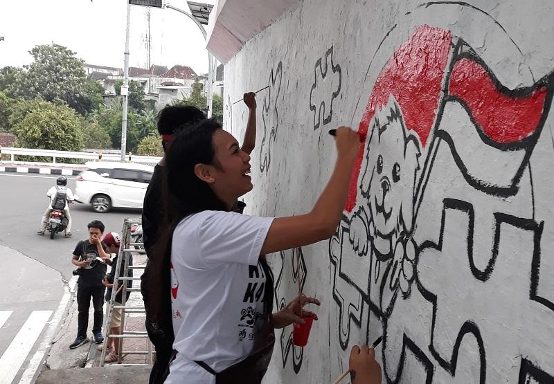 https: img.okeinfo.net content 2019 01 30 298 2011645 lukis-mural-miss-indonesia-2018-alya-nurshabrina-ikut-kampanyekan-stop-konsumsi-daging-anjing-mqcdLcodLF.jpg