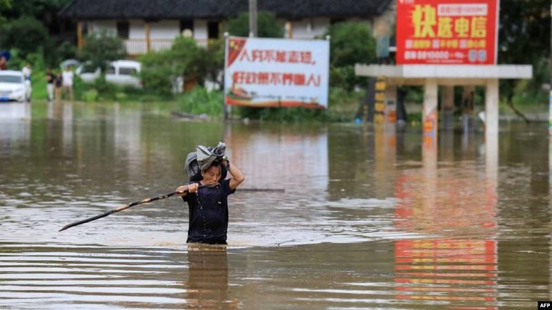 https: img.okeinfo.net content 2019 06 13 18 2065873 banjir-akibat-hujan-lebat-tewaskan-49-orang-di-china-9FjYW7GxCJ.jpg