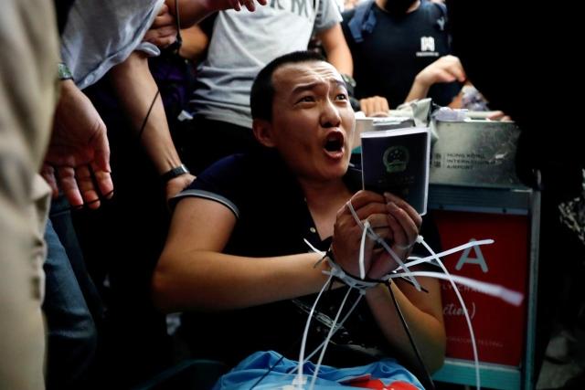 https: img.okeinfo.net content 2019 08 14 18 2091684 global-times-sebut-wartawannya-ditahan-pedemo-dibebaskan-polisi-hong-kong-8mggsRkuXz.jpg