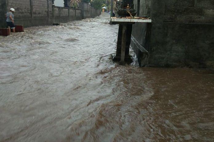 https: img.okeinfo.net content 2020 03 02 244 2176613 hujan-deras-banjir-dan-pohon-tumbang-landa-gianyar-bali-fLcMAYMXgs.jpeg