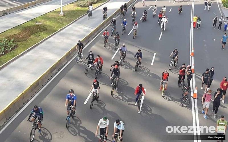 https: img.okeinfo.net content 2020 06 29 481 2237992 amankah-bersepeda-memakai-masker-di-masa-pandemi-covid-19-k12DhlAZwi.jpg