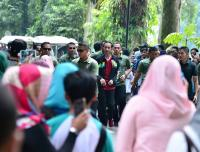 Kenakan Jersey Timnas Indonesia, Jokowi Olahraga di Kebun Raya Bogor