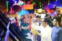 Di Medan, Ada Pengamen yang Berhasil Mengocok Perut Jokowi