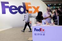 China Selidiki Paket FedEx dari Amerika Serikat Berisi Pistol