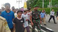 TNI Bebaskan 9 WNI Korban Salah Tangkap Tentara Malaysia