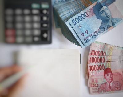 BI Tahan Suku Bunga Acuan, Rupiah Tertekan ke Rp14.070 USD