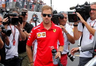 Red Bull Ingin Pulangkan Vettel dari Ferrari