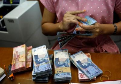 Akhiri Pekan Ini, Rupiah Ditutup Menguat di Rp14.215 USD