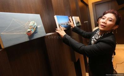 Viral! Menteri Susi Pudjiastuti Berpose Layaknya Artis di Perpisahan Kabinet Kerja